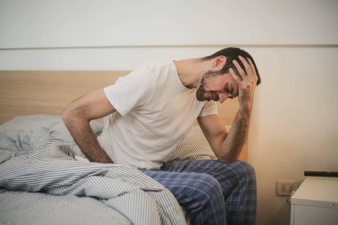 man experiencing a severe migraine