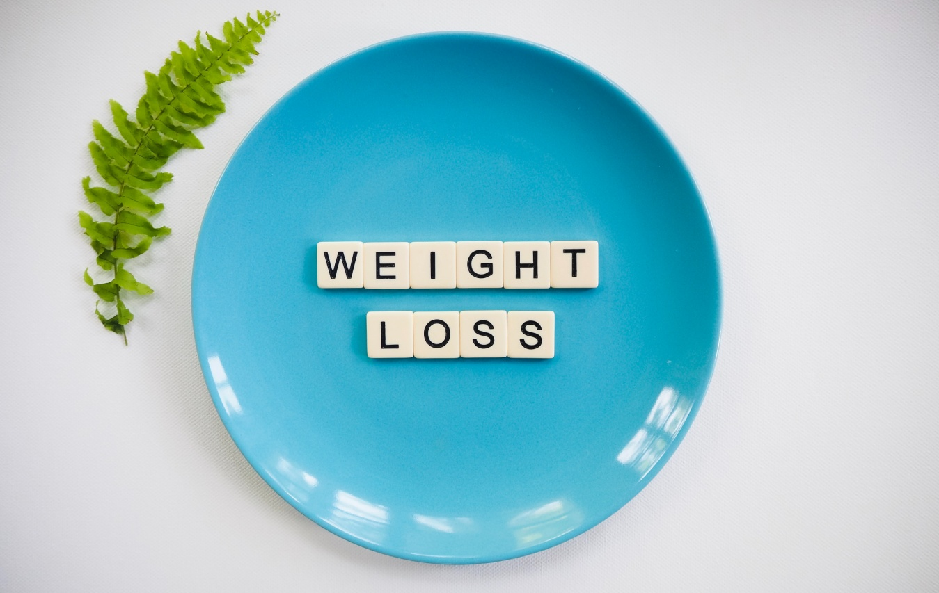 A sign reading weight-loss