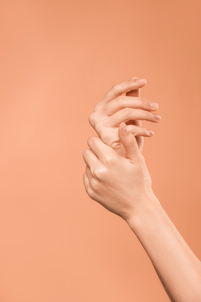 Woman moisturizing hands with Chaga Body Butter